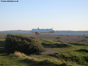 A large boat passes along the Solent