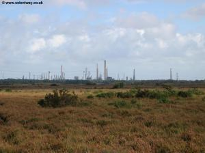The towers of Fawley Refinery in the distance